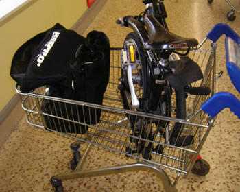 Brompton and bag in the trolley.