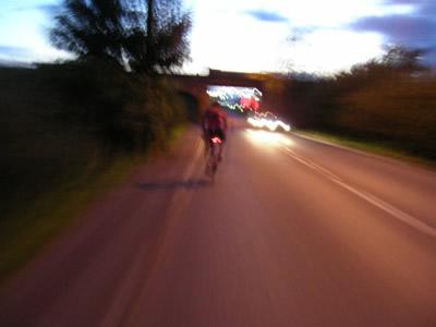 John cycles through thedusk