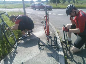 Andy adjusts his pedals, John repairs his wheel and tyre - as usual