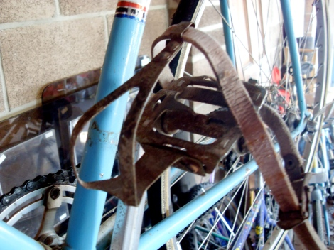 Steel clips and leather straps